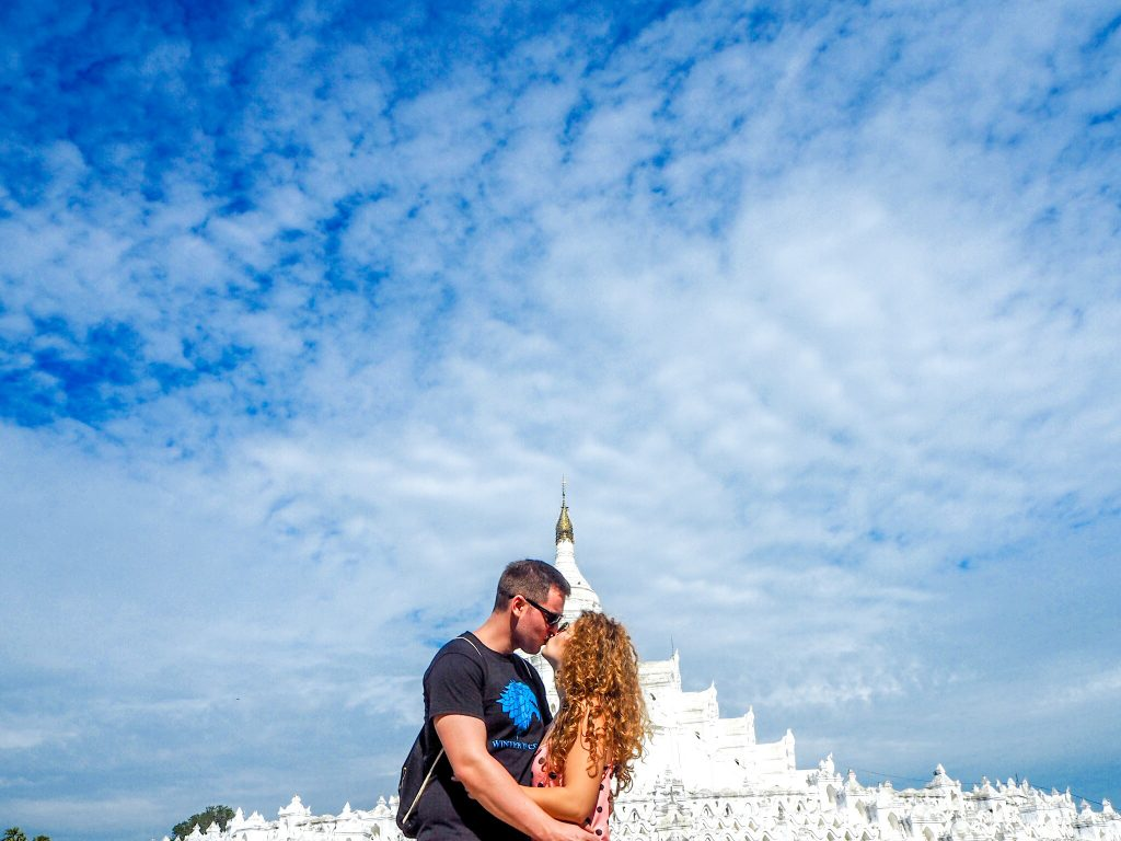 Travel couple in front of the Hsinbyume Pagoda Mingun Myanmar