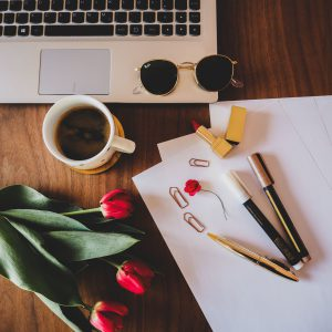 Working space with coffee and tulips